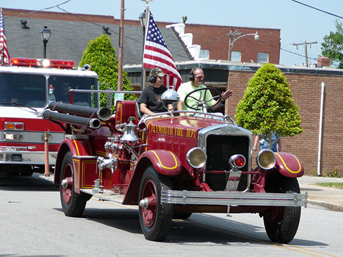 Colorful old fire engine was a hit with truck parade spectators.
