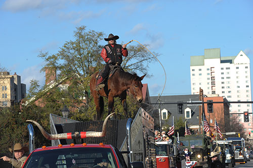 Rodeo entertainer John Payne rides on top of his mule, Moe.
